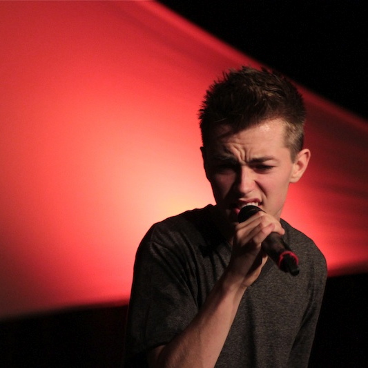 Aspiring musician Caleb Bigler sings at a concert he held last November. Credit: Jackson Tovar/The Foothill Dragon Press