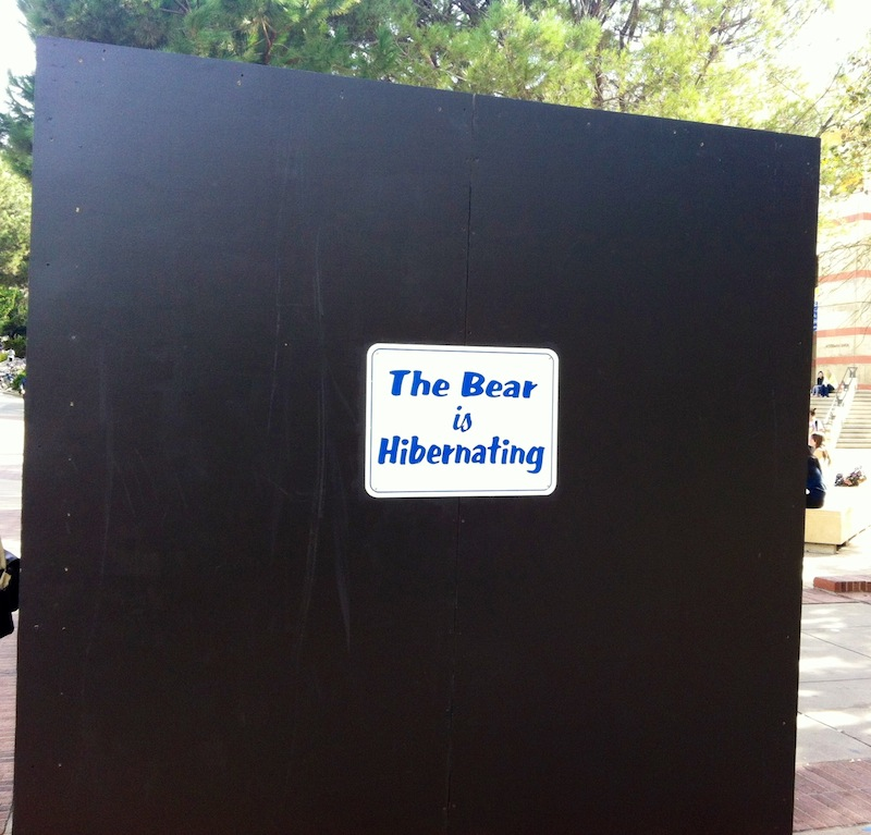 """UCLA's Bruin statue """"goes into hibernation"""" beneath this black box to avoid potential USC pranks during Rivalry Week. UCLA students often camp out overnight to provide extra protection for the statue. Credit: Anaika Miller."""