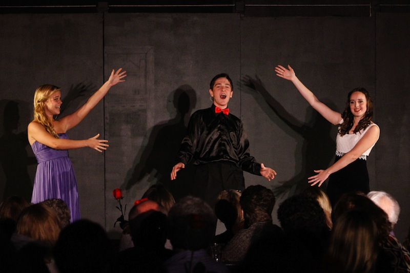From left, Foothill senior Annabelle Warren, Ventura junior Jacob Mizraji, and Foothill senior Marnie Vaughan perform at the Company show choir dinner theatre. Credit: Bethany Fankhauser/The Foothill Dragon Press