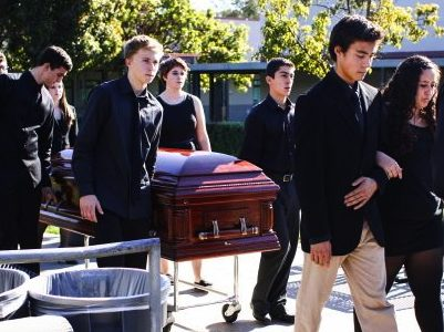 "The ""dead"" students bring two caskets through the center of the quad to represent senior Marnie Vaughan and junior Carly Camarillo. Credit: Aysen Tan/The Foothill Dragon Press"