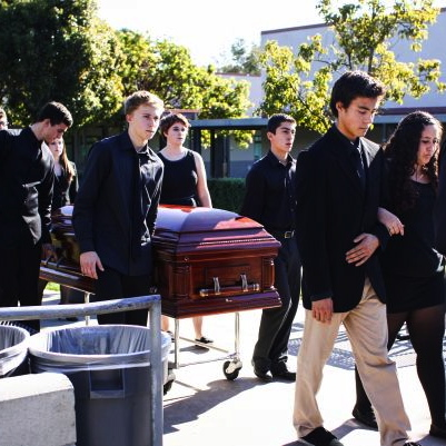 """The """"dead"""" students bring two caskets through the center of the quad to represent senior Marnie Vaughan and junior Carly Camarillo. Credit: Aysen Tan/The Foothill Dragon Press"""