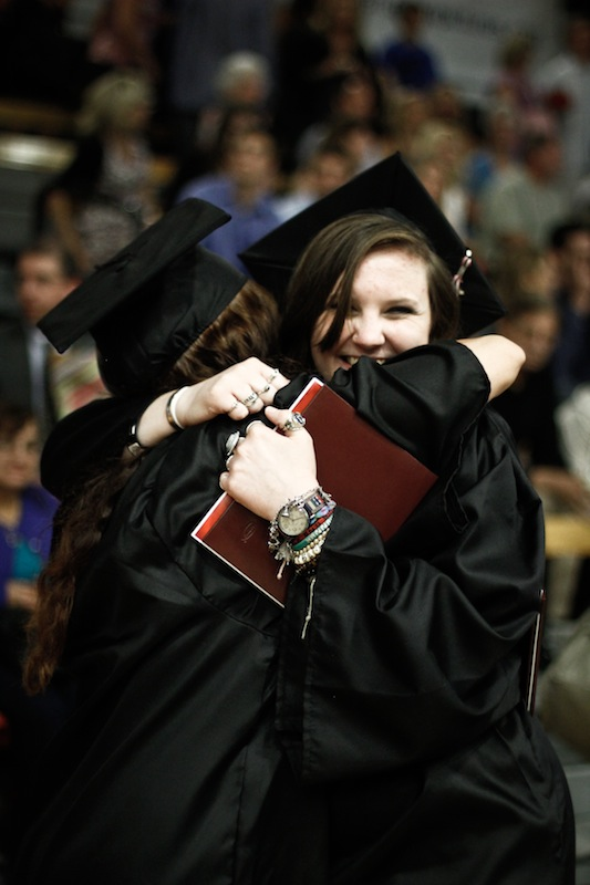 Senior Hannah Strohman hugs a fellow graduate at Foothill's 2012 Commencement ceremony. Credit: Bethany Fankhauser/The Foothill Dragon Press