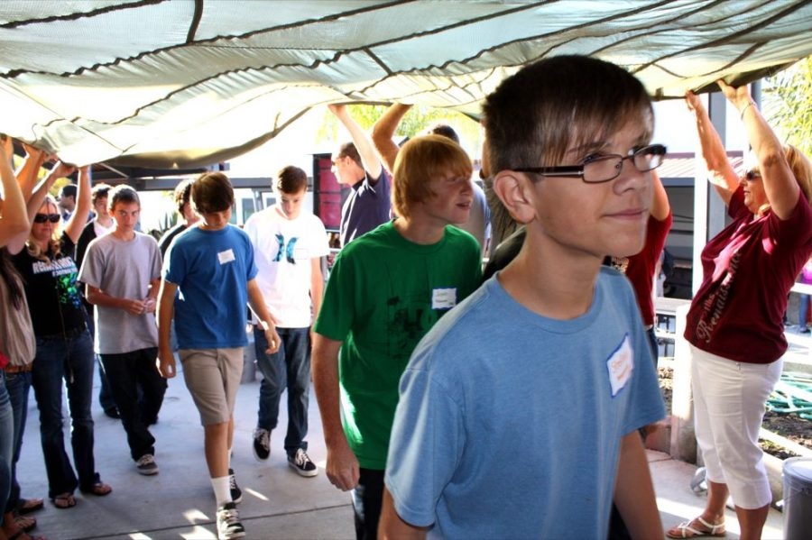 Incoming freshmen entered Spirito Hall Thursday for their orientation by walking through a tunnel formed by Foothill teachers and administrators. Credit: Chrissy Springer/The Foothill Dragon Press.