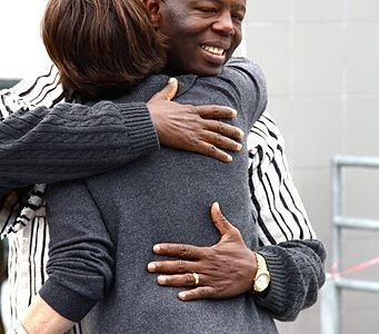 Joseph Lamin hugs Foothill English teacher Melissa Wantz who was one of the teachers that helped organize fundraisers to sponsor a school in Lungi, Sierra Leone. Credit: Bethany Fankhauser/The Foothill Dragon Press.