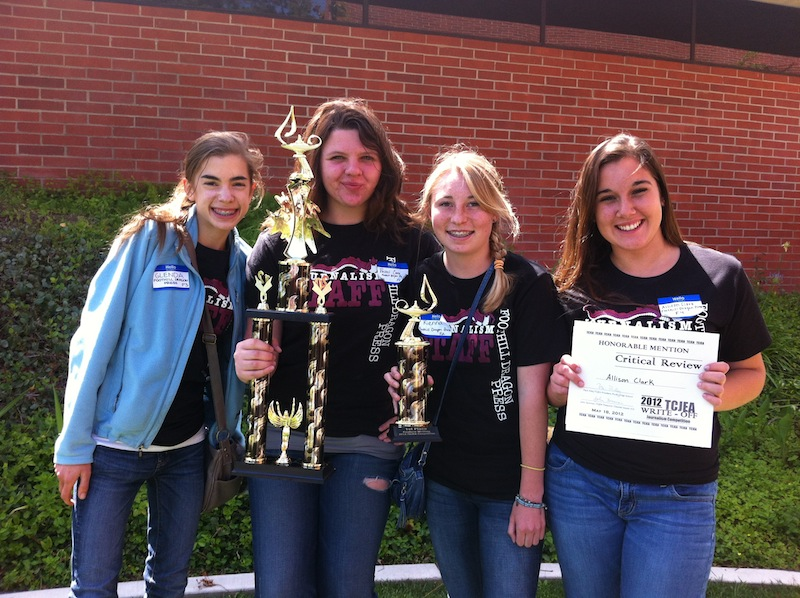 From left to right, sophomore Glenda Marshall, junior Rachel Crane, sophomore Kienna Kulzer, and sophomore Allison Clark competed at a competition held by the Tri-County Journalism Education Association Friday. Credit: Melissa Wantz. Used with permission.