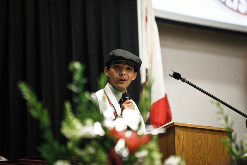 """Kevin Kunes gives his speech """"A Much Larger World"""" at the graduation ceremony Wednesday. Credit: Bethany Fankhauser/The Foothill Dragon Press."""