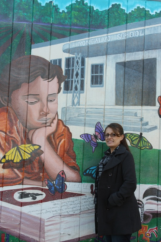 Local artist Veronica Valadez stands in front of a mural she painted with the help of others at Montalvo Elementary School. Credit: Veronica Mellring/The Foothill Dragon Press