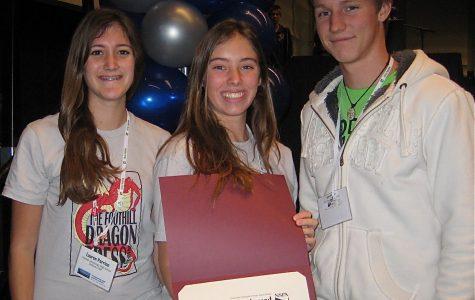From left, Lauren Parrino, Anaika Miller and Trevor Jordan accept the second place Best of Show award on behalf of the Foothill Dragon Press Saturday in Kansas City, Mo. Credit: Melissa Wantz.