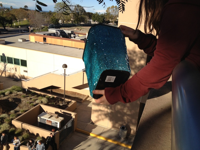 Junior Megan Witters prepares to drop her egg container off of the Science and Technologies building at Ventura College. Credit: Benjamin Limpich/The Foothill Dragon Press