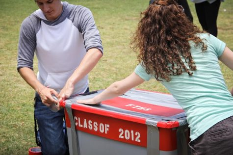 Seniors Trevor Kirby and Shaena Singer tape Foothill's first time capsule at the senior picnic. Credit: Bethany Fankhauser/The Foothill Dragon Press.