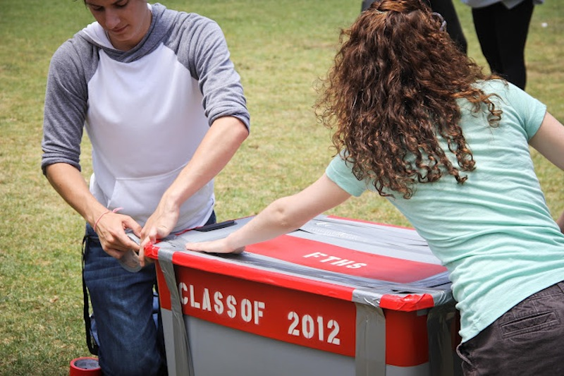 Seniors Trevor Kirby and Shaena Singer tape Foothills first time capsule at the senior picnic. Credit: Bethany Fankhauser/The Foothill Dragon Press.