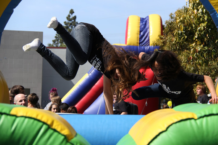 Sophomores Joceyln Carrol and Michelle Pablo race on the inflatable obstacle course at Fridays Renaissance rally. Credit: Josh Ren/The Foothill Dragon Press
